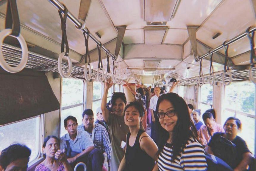 Singaporean Joyann Lim (in black, standing) taking a public bus in Myanmar.