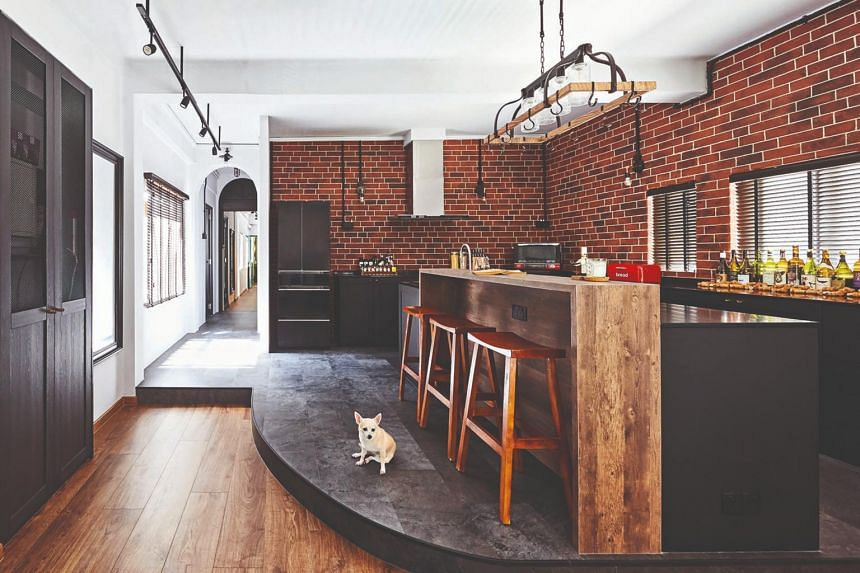 The exposed brick and black accents give the space a distinctly industrial vibe.