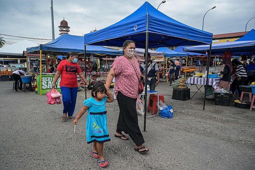 People visit a market ahead of its final night before closing, in Karak, Pahang, on Jan 20, 2021.