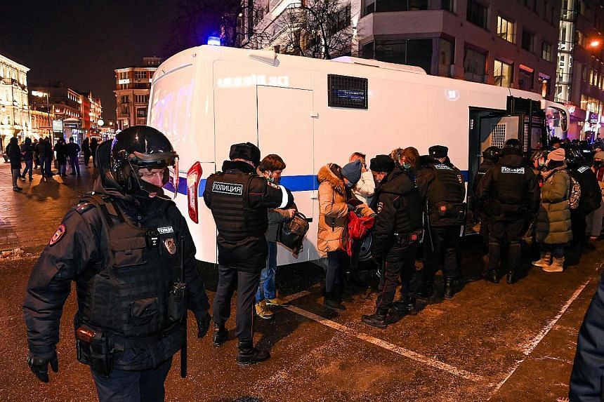 Police detain people during a protest in downtown Moscow, on Feb 2, 2021.