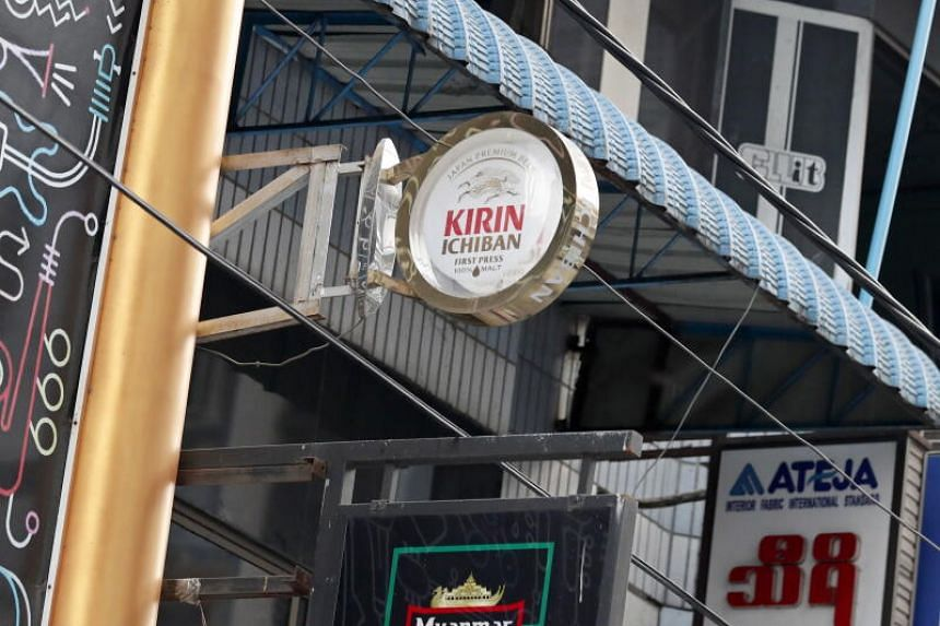Japan brewer Kirin Holdings said it was ending its joint ventures with Myanmar Economic Holdings on Feb 5, 2021.