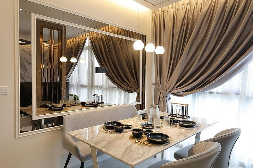 Interior design firm Stylemyspace's luxurious design for a two-bedroom condominium in Symphony Suites in Yishun.