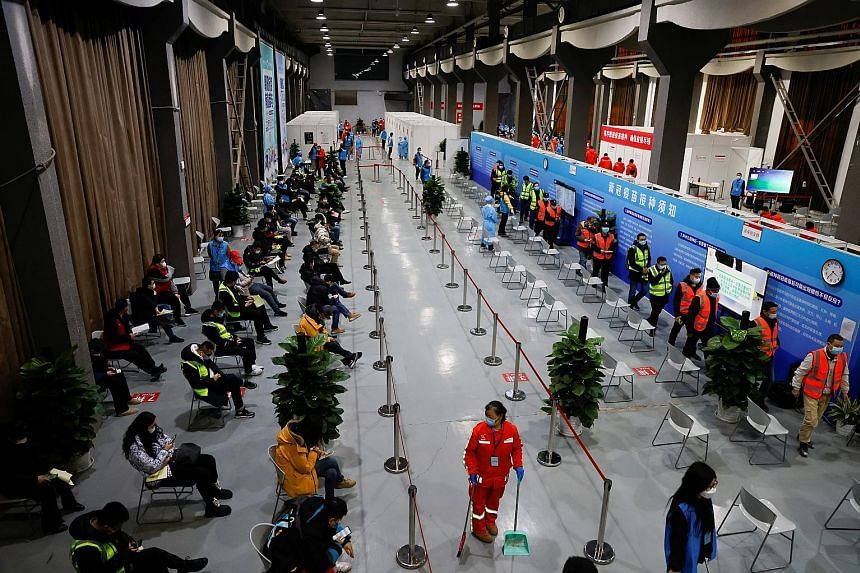 A vaccination centre (below) in Beijing last month. As vaccinations are being administered more rapidly in wealthier Western countries, such nations are likely to beat Covid-19 much sooner than poorer nations and those with massive populations, such