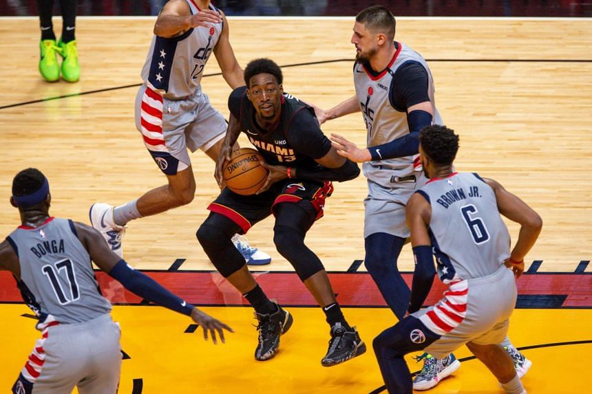 Miami Heat center Bam Adebayo drives the basketball around Washington Wizards forward Davis Bertans on Feb 5, 2021.