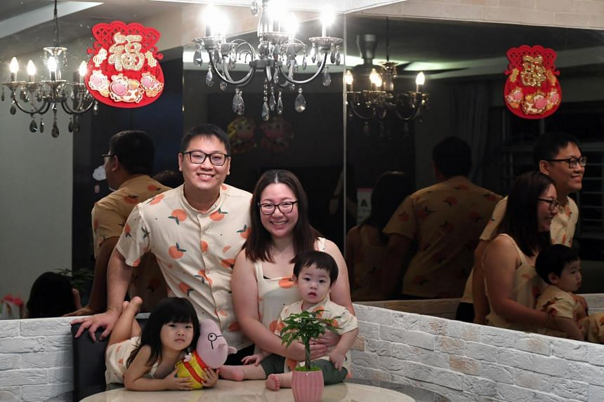 Ms Steffi Ng with her husband Lee Wen Jie and their children at their Yishun home.