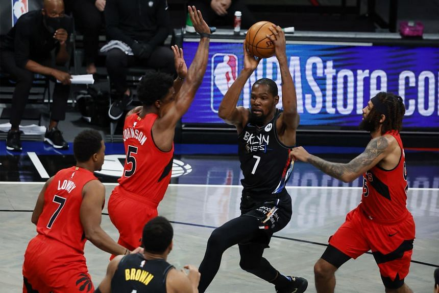 The Brooklyn Nets' Kevin Durant tries to run towards the basket past the Toronto Raptors defence on Feb 5, 2021.