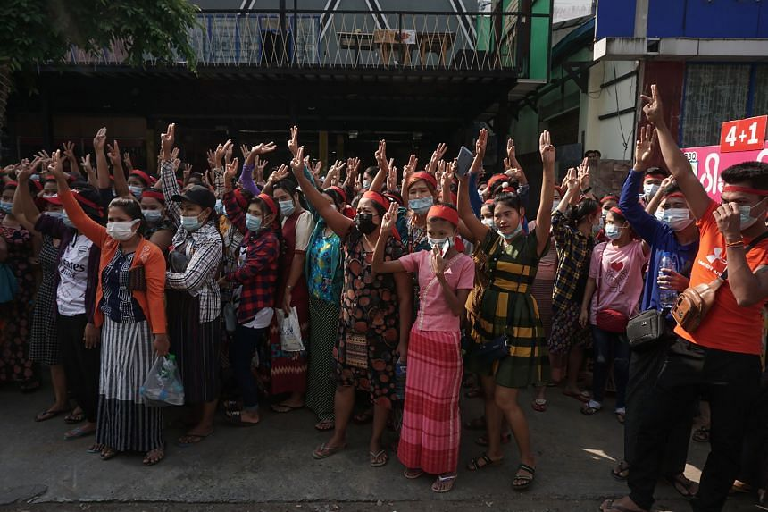 Protesters hold up the three-finger salute during a demonstration against the military coup in Yangon, on Feb 6, 2021.