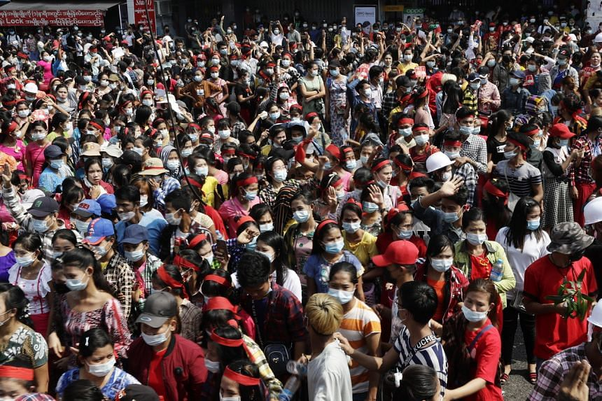 Protesters gather in a demonstration against the military coup, in Yangon, Myanmar, on Feb 6, 2021.