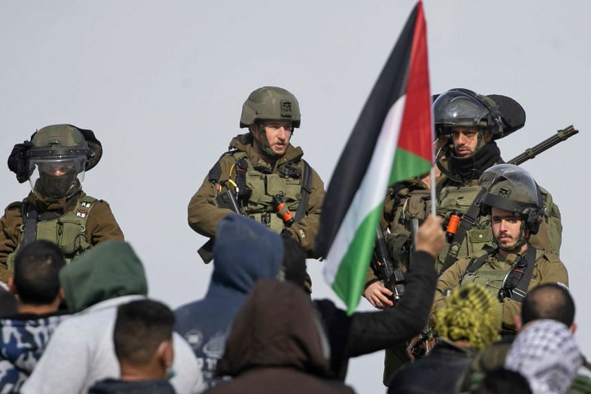 Palestinian protesters confront Israeli security forces during a demonstration against the expansion of settlements in the occupied West Bank on Feb 5, 2021.