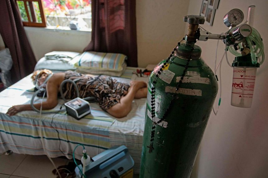 Dilza Maria Pereira Rodrigues, 71, receives treatment for Covid-19 at her home after 15 days of treatment at the hospital in Manaus, Brazil on Jan 2, 2021.