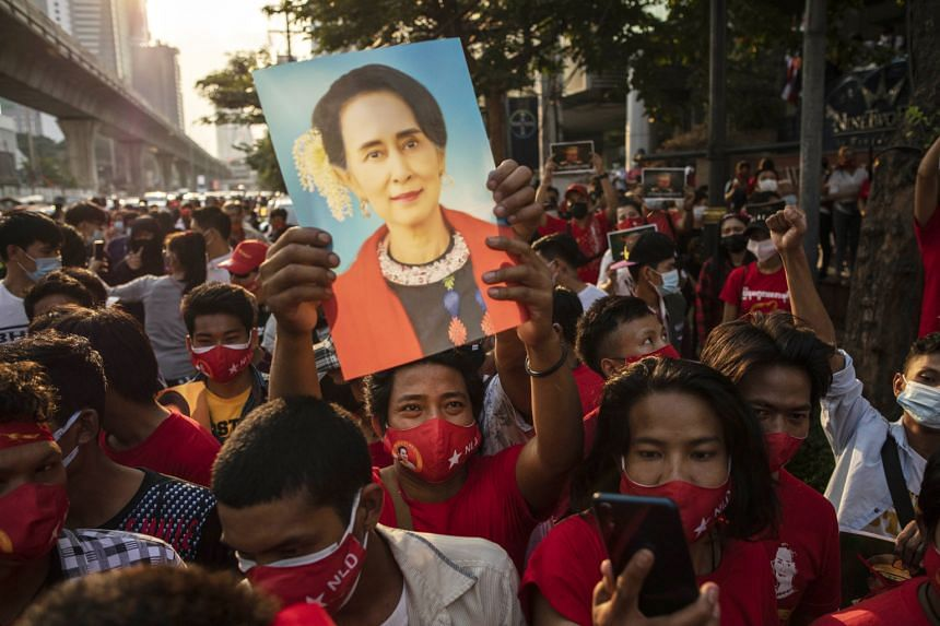 A demonstrator holds up an image of Aung San Suu Kyi during a protest outside the Embassy of Myanmar in Bangkok, on Feb 1, 2021.
