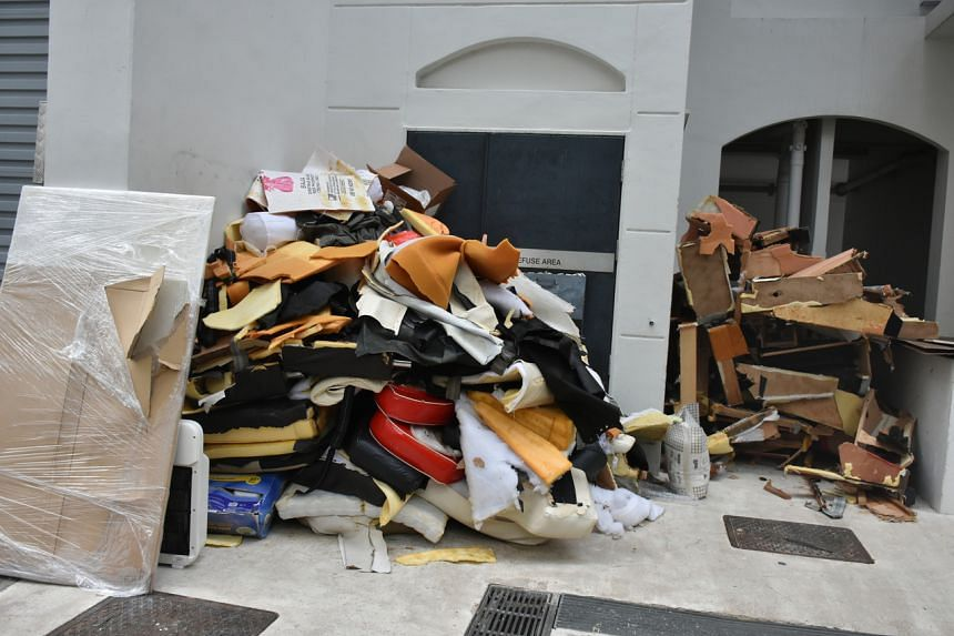 Broken furniture and unwanted items in a corner at Boon Tiong.