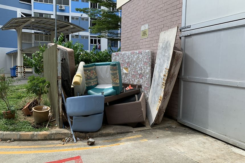 Unwanted furniture left at a bin centre at Lorong 6 Toa Payoh.