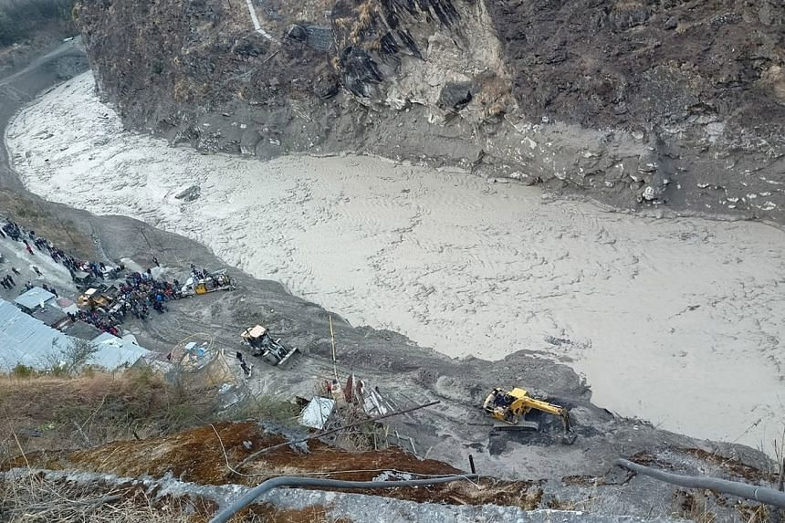 Rescue operations going on near the Dhauliganga hydro power project, at Reni village in Chamoli, India, on Feb 7, 2021.