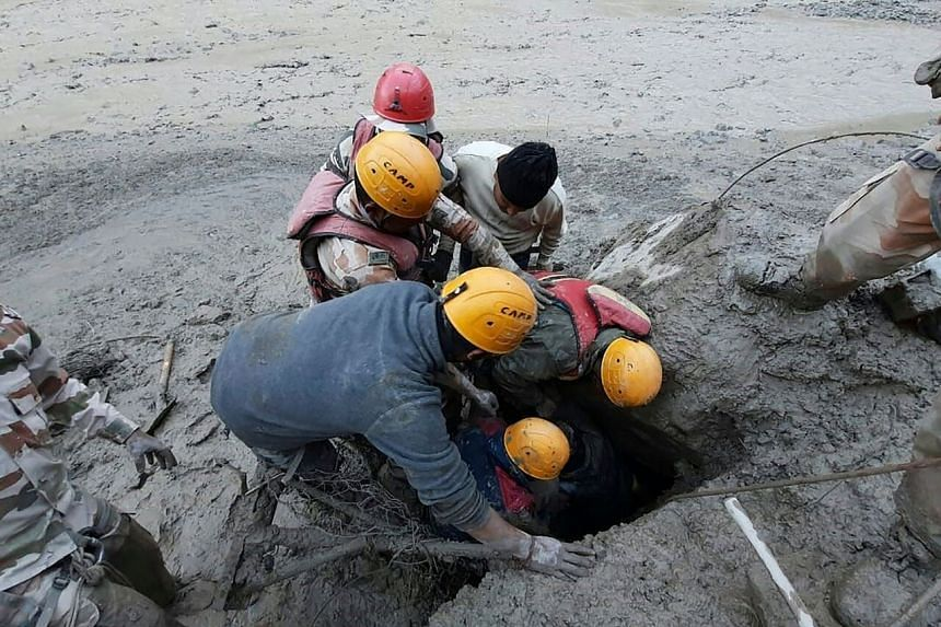 Members of the Indo-Tibetan Border Police conducting a rescue operation following the breaking of the glacier, at Reni village in Chamoli district, India, on Feb 7, 2021.