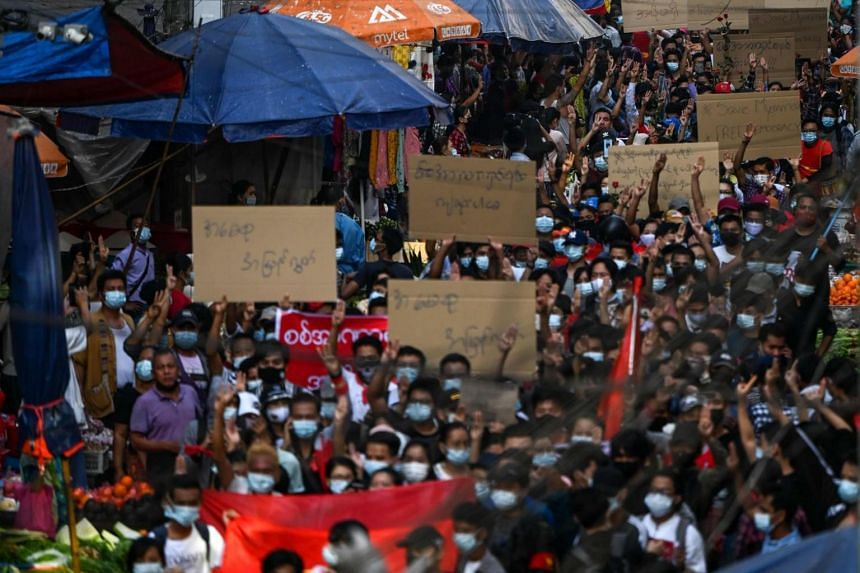 Protesters take part in a demonstration against the military coup in Yangon on Feb 7, 2021.