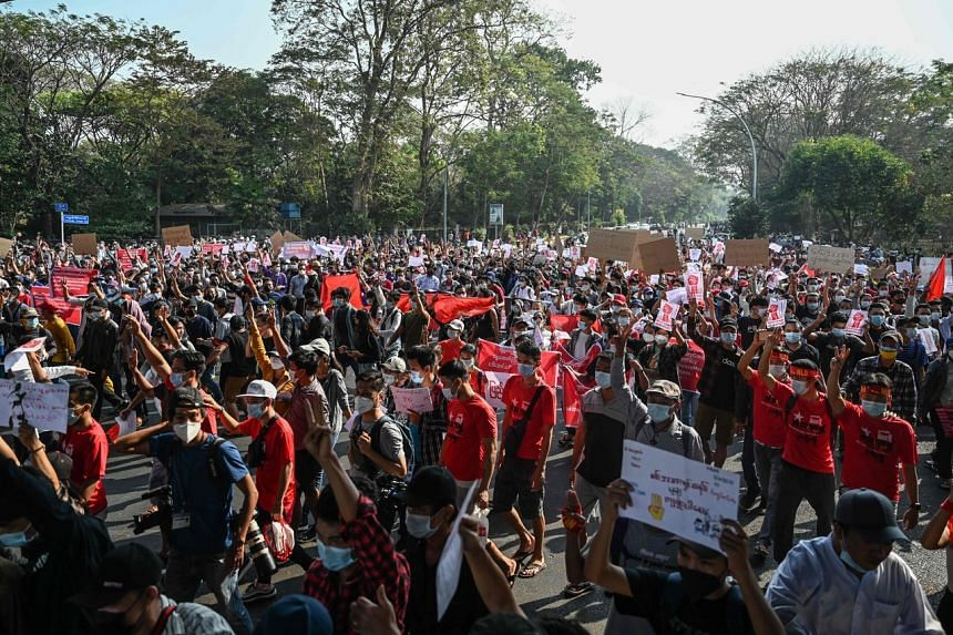 People are seen during a protest against the military coup in Yangon on Feb 7, 2021.