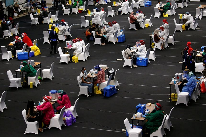 A mass vaccination for medical workers at Istora Senayan indoor stadium in Jakarta on Thursday. While Vietnam and Thailand will not be sufficiently immune until the middle of next year at the earliest, Indonesia's ambition to vaccinate 181.5 million