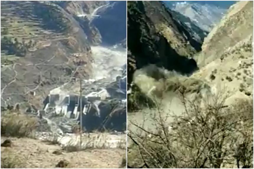 Water could be seen surging through a small dam site, washing away construction equipment, after a Himalayan glacier broke on Feb 7, 2021.