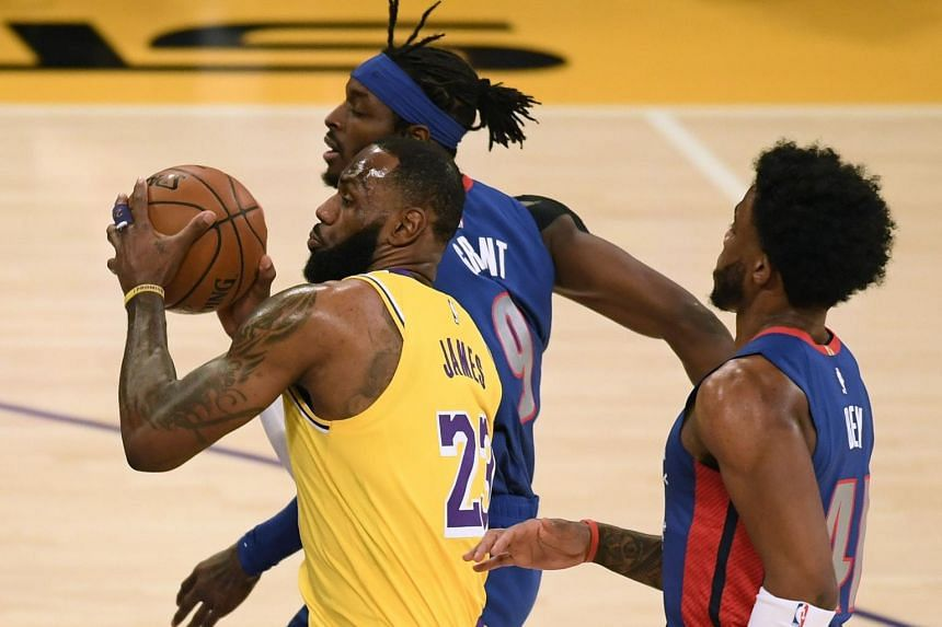 LeBron James (left) drives to the basket between Jerami Grant and Saddiq Bey (right) at Staples Center in Los Angeles, on Feb 6, 2021.