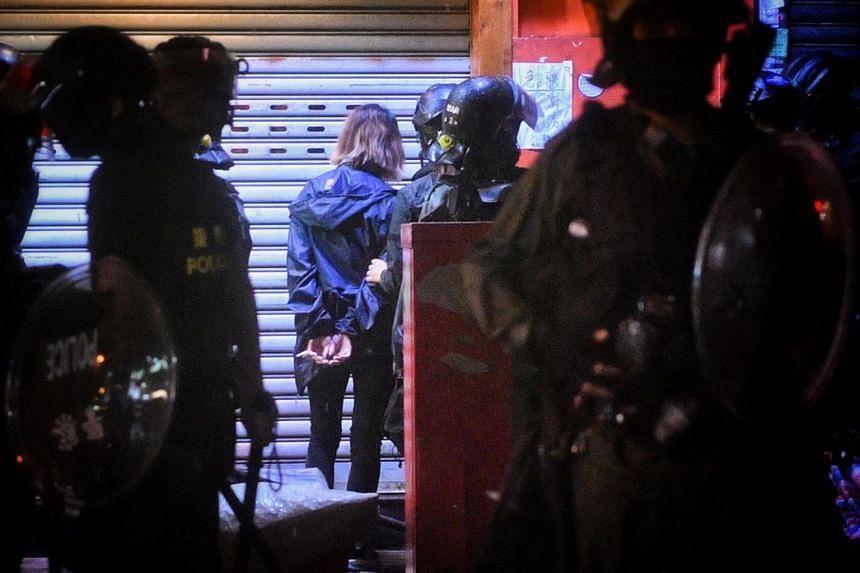 Hong Kong police arrest a girl in Mong Kok, Hong Kong, on Oct 6, 2019.