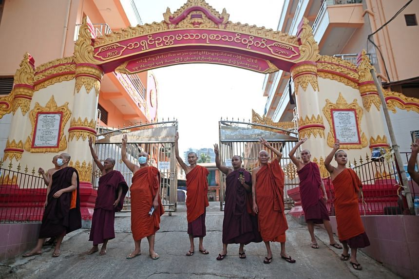 Buddhist monks join a rally to protest against Myanmar's military coup in Yangon on Feb 8, 2021.