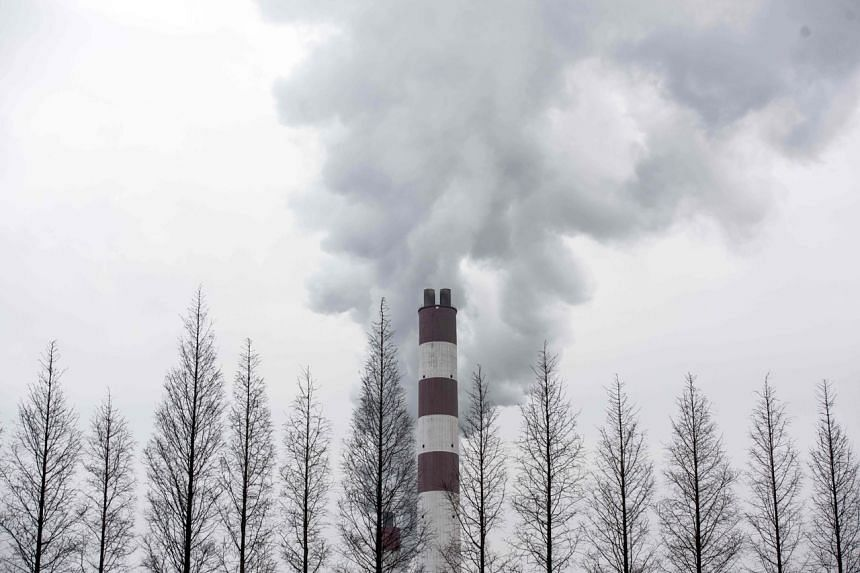 Smoke billowing from a chimney of the Shanghai Waigaoqiao Power Generator Company coal power plant in Shanghai on March 22, 2016.