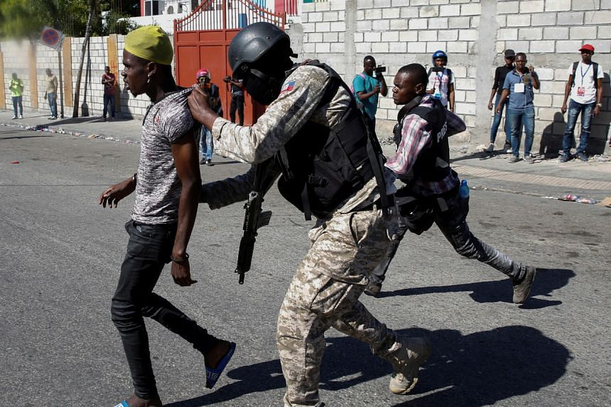 Police detain a man during protests against Haiti's President Jovonel Moise in Port-au-Prince, Haiti, on Feb 7, 2021.