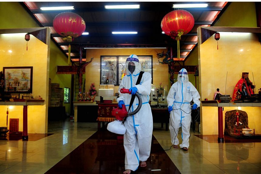 Kim Geok Tuar temple in Selangor being disinfected yesterday. Chinese New Year prayers at temples in Malaysia will now be allowed this Thursday, Friday and on Feb 19.