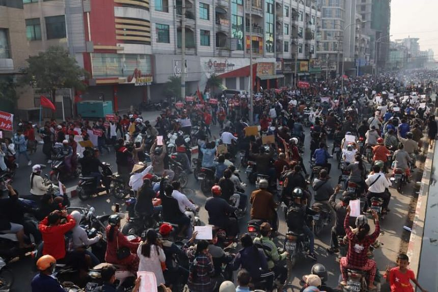 People protest against Myanmar's military coup in Mandalay on Feb 8, 2021.