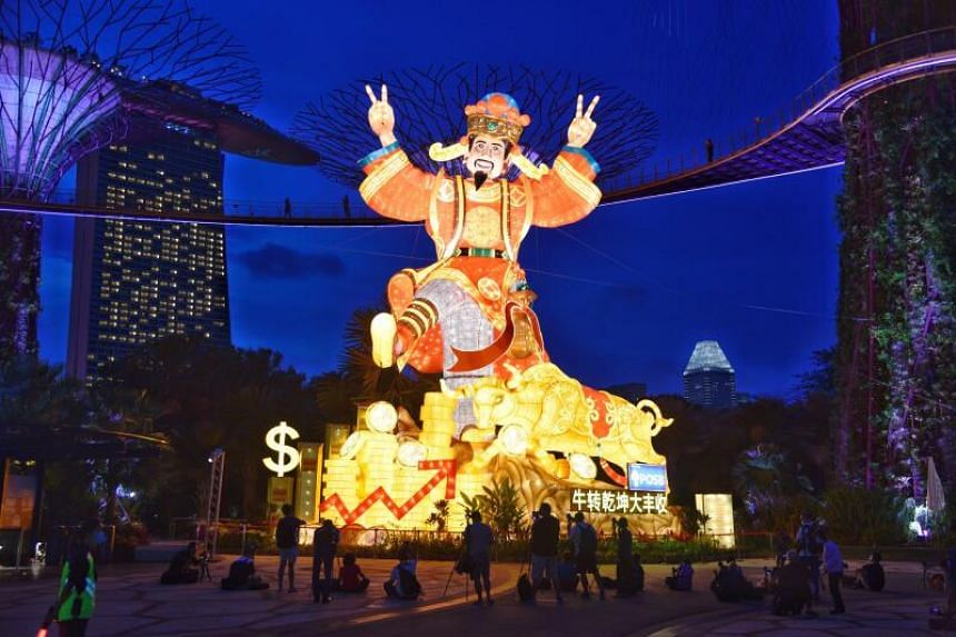 An 18m-tall God of Fortune set among the Supertrees is among the displays at this year's River Hongbao.