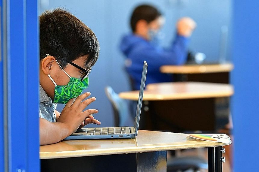 A quarter of Singapore parents surveyed said their children experienced cyber bullying last year, up from 16 per cent in 2019. PHOTO: AGENCE FRANCE-PRESSE