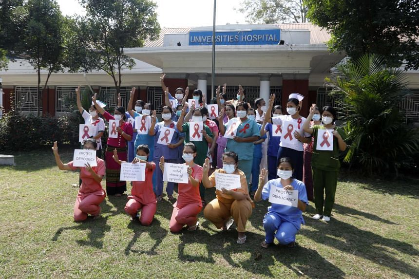 Doctors and nurses participate in the civil disobedience campaign against the military coup in Yangon, on Feb 5, 2021.