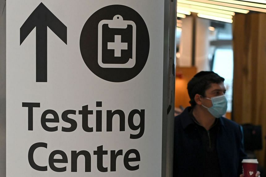A sign directs passengers to a Covid-19 testing centre at Terminal 5 of London's Heathrow Airport.