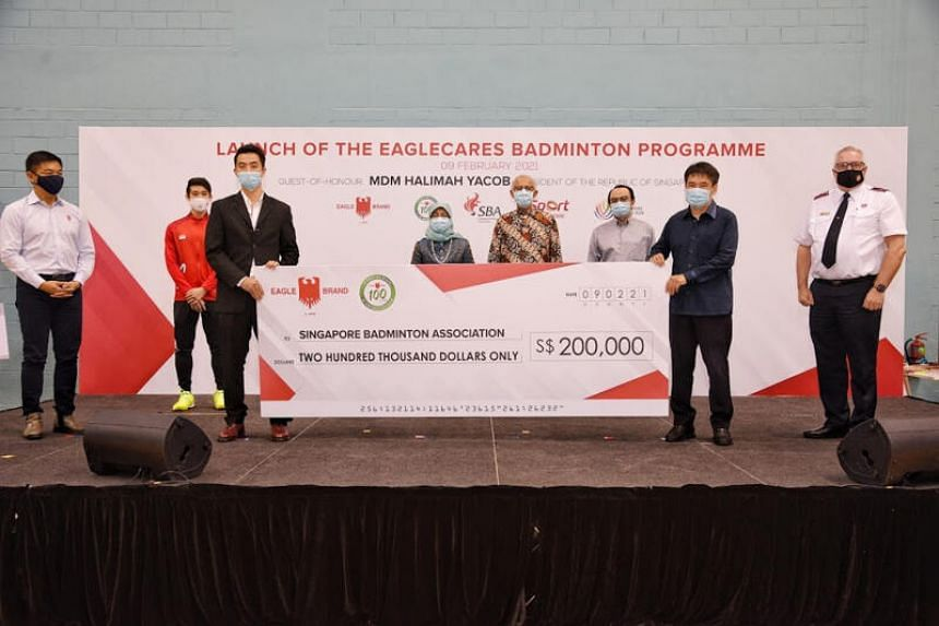 President Halimah Yacob and her husband, Singapore Badminton Association (SBA) patron-in-chief Abdullah Alhabshee (middle), with representatives from the Singapore National Olympic Council, Borden Eagle Group, SBA and the national badminton team at t