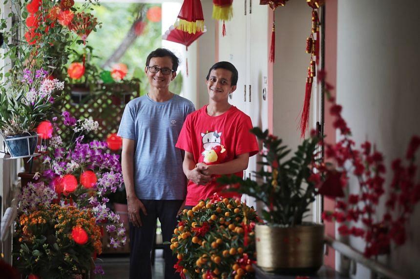 Mr Abdullah Abdul Rahman (right) and his elder brother Mr Azman Salleh outside their Tampines flat, on Feb 8, 2021.