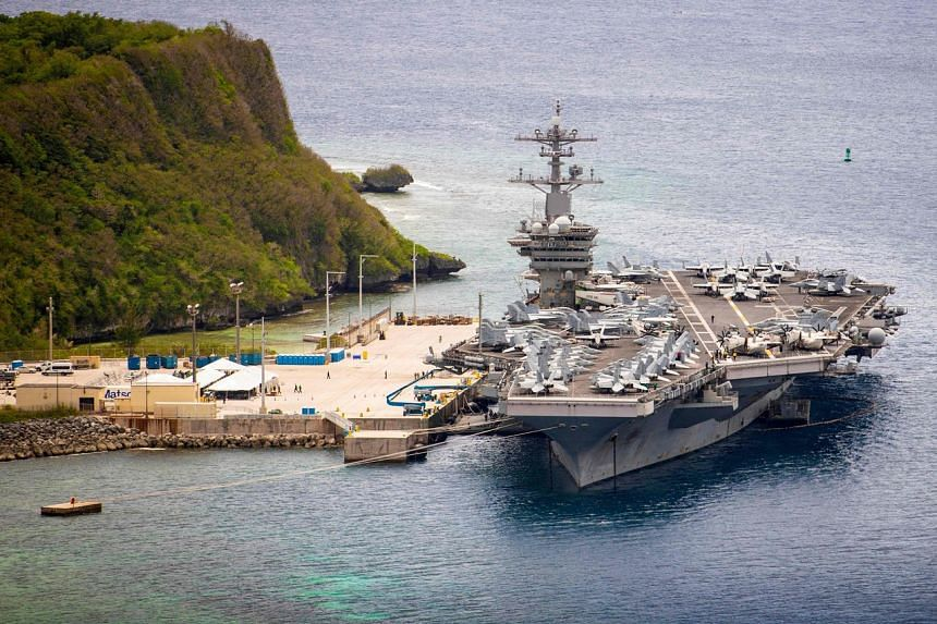 The aircraft carrier USS Theodore Roosevelt (CVN 71) as it is moored pier side at Naval Base Guam, on May 15, 2020.