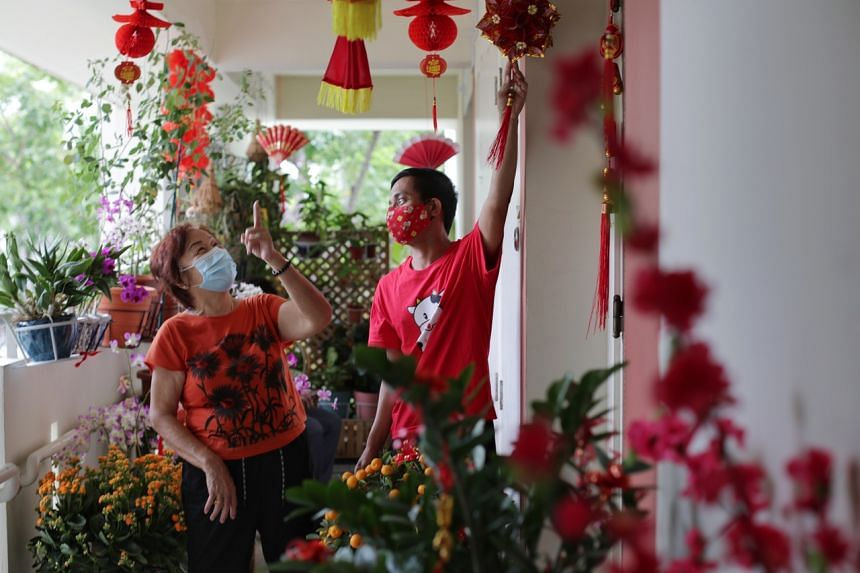 Mr Abdullah Abdul Rahman and his neighbour Madam Mary Tay admiring the Chinese New Year decorations on Feb 8, 2021.