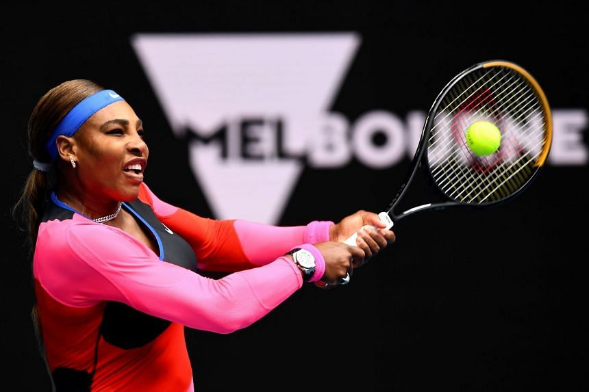 Serena Williams of the US hits a return against Germany's Laura Siegemund during their women's singles match on day one of the Australian Open tennis tournament in Melbourne on February 8, 2021.