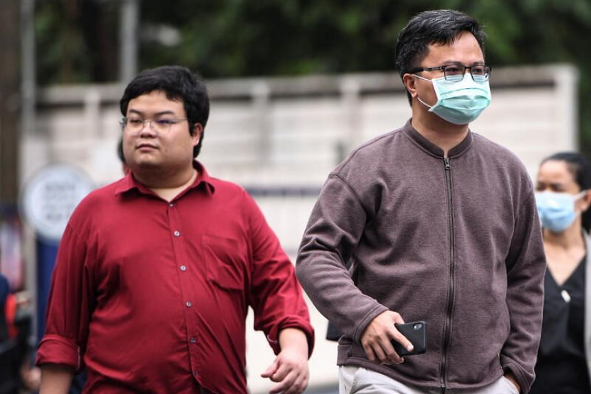 Protest leader Parit Chiwarak (left) and human rights lawyer Arnon Nampa arrive at a criminal court in Bangkok, on Feb 9, 2021.