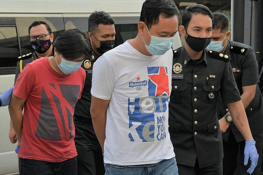 Yong Chee Keong (left) and Chong Kim Kuang, respectively the director and manager of a frozen food firm based in Senai, Johor, are accused of using fake halal logos on dozens of packages of meat not certified to be halal.