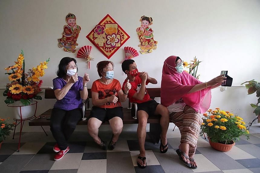 Mr Abdullah Abdul Rahman and his neighbours - (from far left) Madam Chen, 70, who declined to give her full name, Madam Mary Tay, 70, and Madam Rasida A. Rahman, 62 - taking a picture at the fourth-floor lift landing of their block in Tampines Street