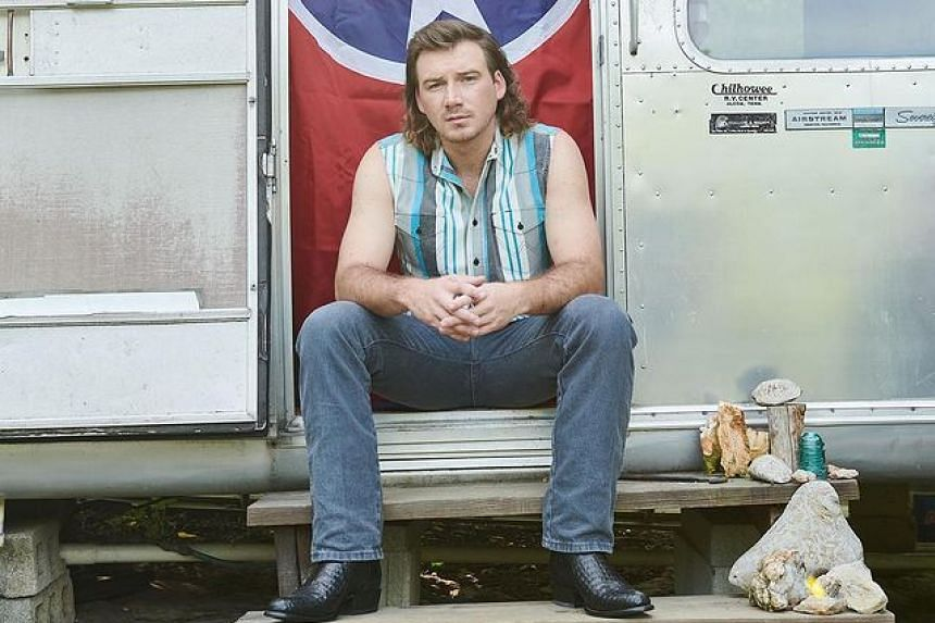 A video surfaced of Morgan Wallen (above) using a racial slur.
