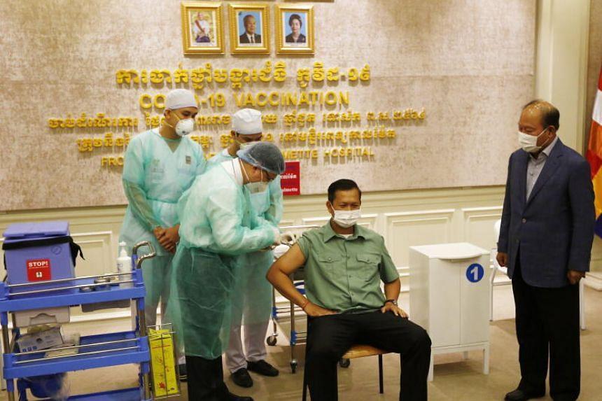Prime Minister Hun Sen's eldest son, Hun Manet receiving a dose of vaccine at Calmette Hospital in Phnom Penh, Cambodia, on Feb 10, 2021.