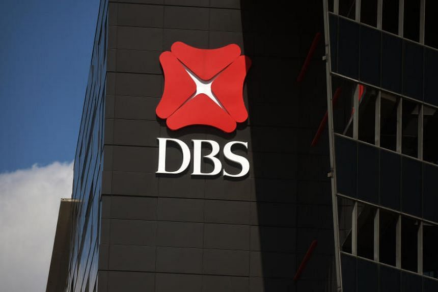 DBS Group reported a 33 per cent plunge in fourth-quarter earnings to $1.01 billion.