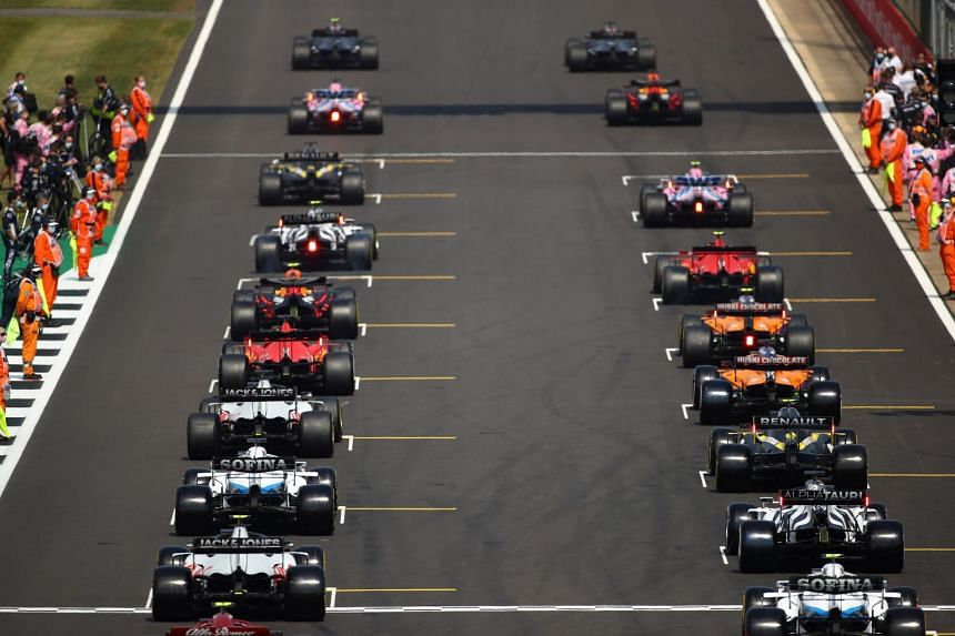 An August 2020 photo shows cars lined up on the grid ahead of the 70th Anniversary Grand Prix.