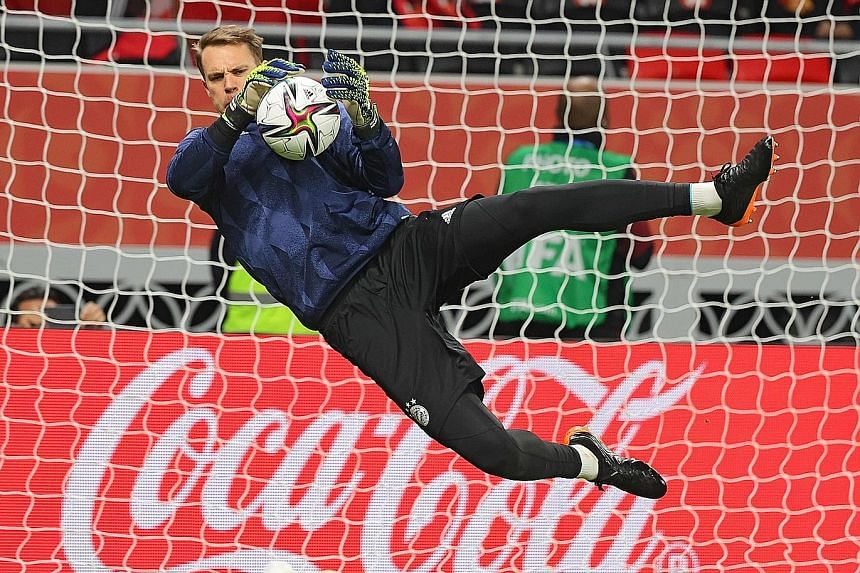 German goalkeeper Manuel Neuer warming up before Bayern's win over Egypt's Al-Ahly in Monday's Club World Cup semi-finals. They meet Mexican team Tigres in today's final.