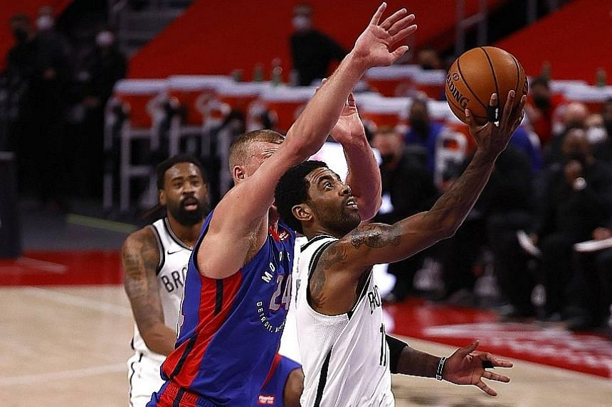 Brooklyn's Kyrie Irving driving past Detroit's Mason Plumlee at Little Caesars Arena in Michigan on Tuesday. The visitors were once more poor in defence in their shock 122-111 loss to the East's bottom side.