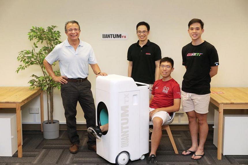 (From left) NUS Associate Professor Alfredo Franco-Obregon, QuantumTx CEO Ivan Goh and national cyclists Darren Lim and Samuel Leong with the Bixeps Wellness Device.