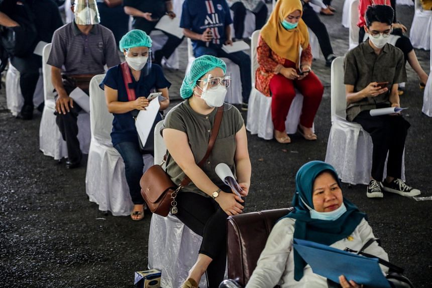 Healthcare workers wait during a mass vaccination drive in Medan, on Feb 10, 2021.
